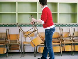 Teacher packing up a classroom .